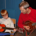 father and son share a tune